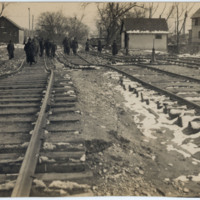 Pedestrians Along the Flood Damaged Railroad Line